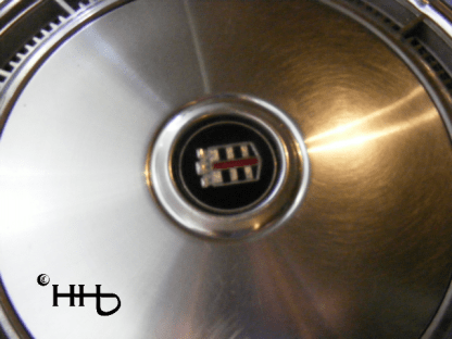close up view of hubcap # c15chry1977_2