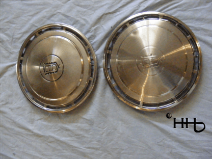 Comparison view of hubcap # c14ford1985_5 and _6