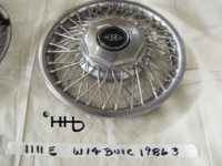 Front profile view of hubcap # w14buic1986_3