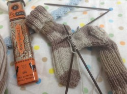 Knitting baby socks with wooden needles