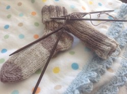 Knitting baby socks
