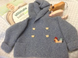 """Hoody jacket knitted with Sidar Denim Sport Aran using a pattern from """"The Ultimate book of Baby Knits"""" by Debbie Bliss."""