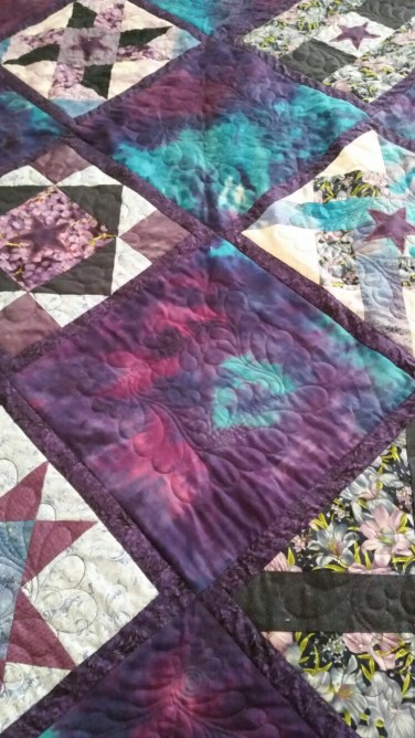 A close up view of a finished block of the quilt I quilted for a friend.