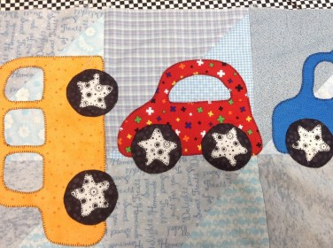Buzy making a car quilt for a 2 year old little man.