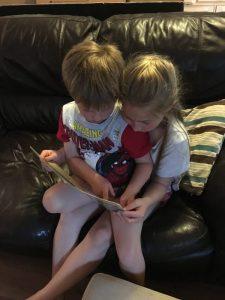 Buzymum - The Boy reading to K