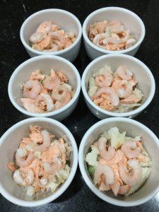Buzymum - Building the fish pies with sauce, fish, sauce then mash