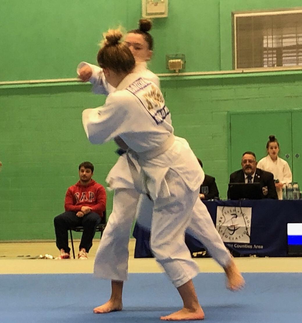 Female judoka fighting