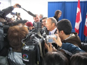 Minister Day gets mobbed by the media!