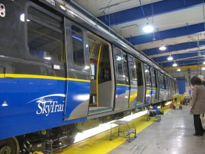 The side of the new SkyTrain cars.