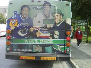 The Crazy Canucks podcast crew, on the back of a bus! (Dave's at far right). Photo from <a href=