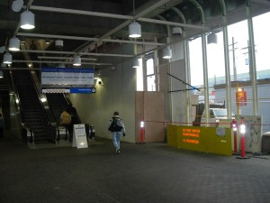 A view of Broadway Station's interior. Glass walls are being installed at the station -- the hoarding on the right is part of the ongoing installation of those walls.