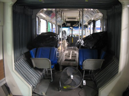 As I was standing inside the back of the bus, I also took a photo of the articulated joint interior and the empty floors up at the front of the vehicle.