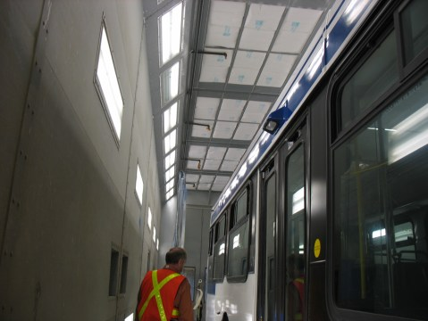 Inside the articulated bus paint booth.