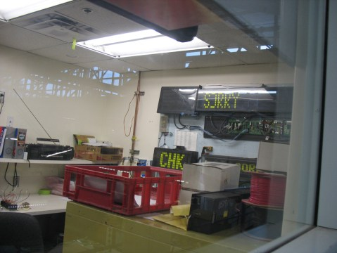 This little office is where they fix the destination signs for the vehicles.
