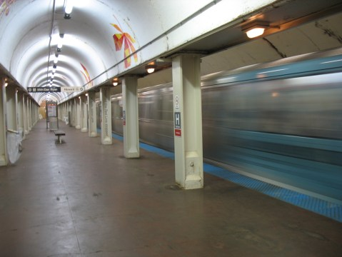 The Red Line zooms through Harrison Station.