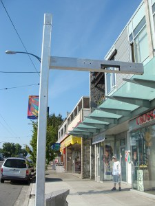 The metal poles at some Main Street bus stops will carry real-time bus arrival displays this fall.