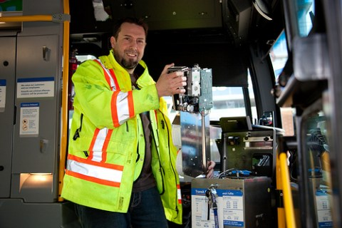Shawn servicing a farebox while a bus is on layover