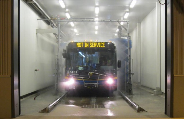 A bus in the car wash at Surrey Transit Centre.