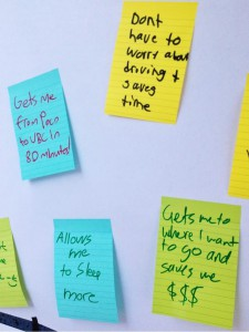 Post-its from our enormous wall poster, asking attendees to let us know what they loved about transit!
