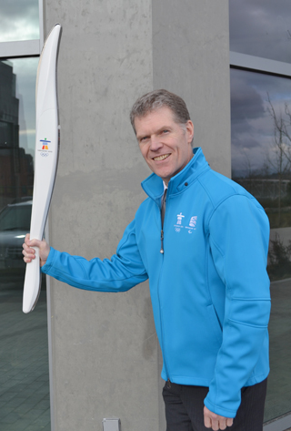 Mike with his souvenir torch and TransLink staff official Winter Olympic jacket