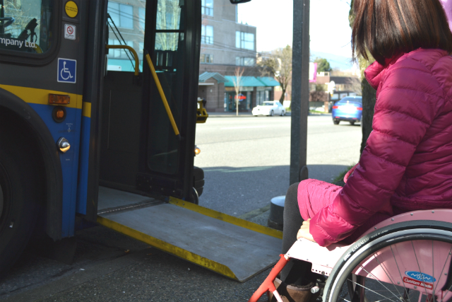 Customer using wheelchair getting on the bus
