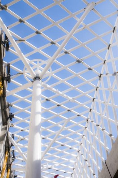 Support column for overhead pedestrian walkway