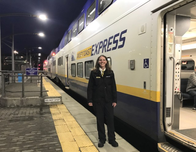 Leanna Turcotte, Train Conductor for West Coast Express stands outside passenger train
