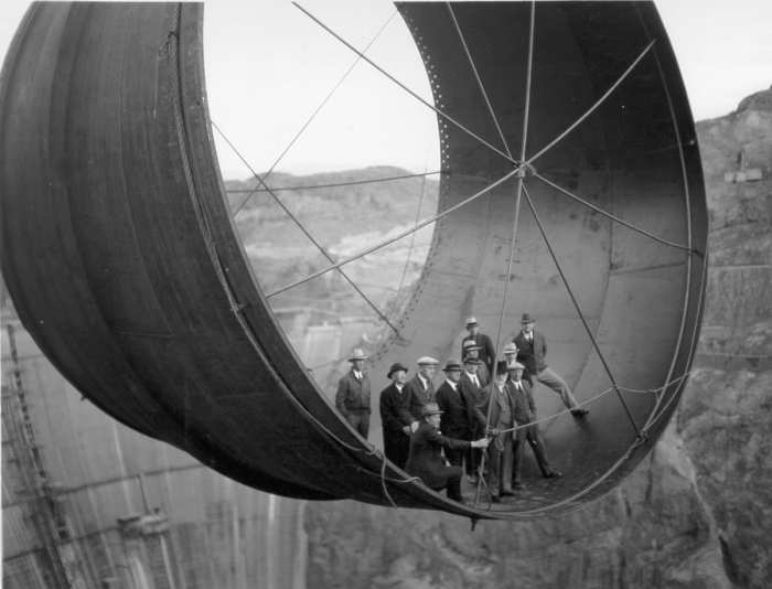 1935 - Officials in a pipe by the soon to be completed Hoover Dam, Arizona - 1