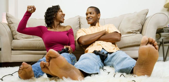 Man and woman playing video game