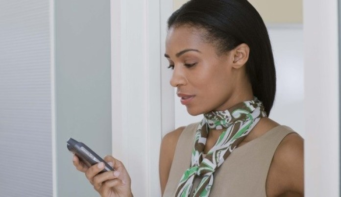 black-woman-looking-at-phone
