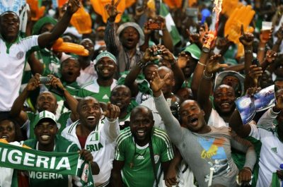 Nigeria fans celebrate in the stands as their team defeated Burkina Faso 1-0 in the final to win the African Cup of Nations soccer tournament, at Soccer City Stadium in Johannesburg, South Africa, Sunday, Feb. 10, 2013. (AP Photo/Rebecca Blackwell)