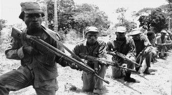 Biafra soldiers carrying gun