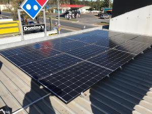 solar panel installation on store's roof.