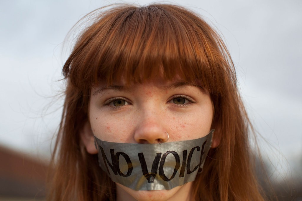 young-OWS-protestor-wore-tape-over-her-mouth-outside-Iowa