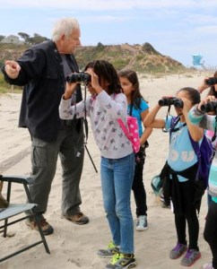 Andy Mauro teaches kids at the Save Our Shores event
