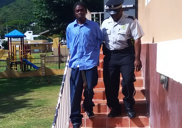 Arian Fahie being escorted on an earlier court appearance