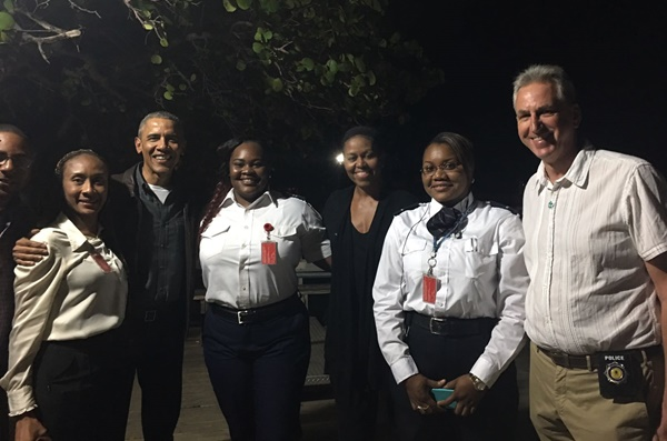 This photo of the Obamas, immigration officers, and Commissioner of Police Michael Matthews in the BVI is being circulated widely on social media