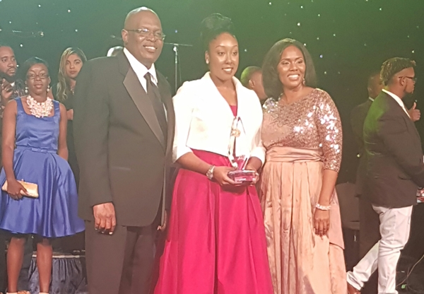 Gabrielle Denae (centre) is all smiles after accepting her award.