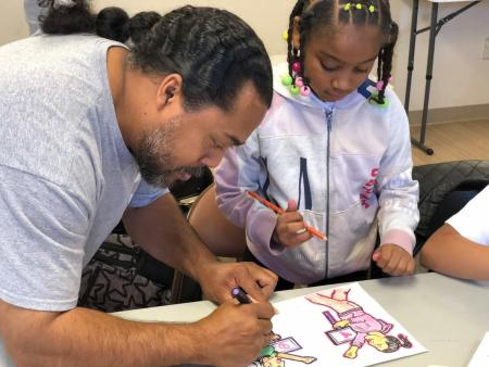 Artist Eustinove Smith teaching mural art