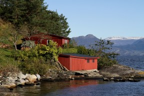A red cabin and a boat-house