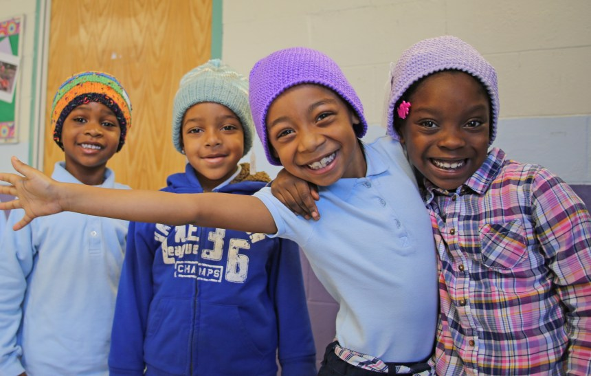 Tobin Elementary School students enjoy their new knit caps.