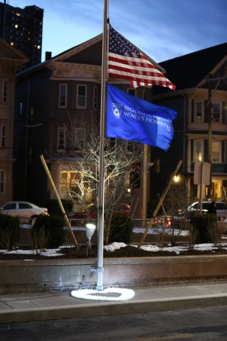 The flags outside 45 Francis St., lit by electric candles on the evening of Jan. 20