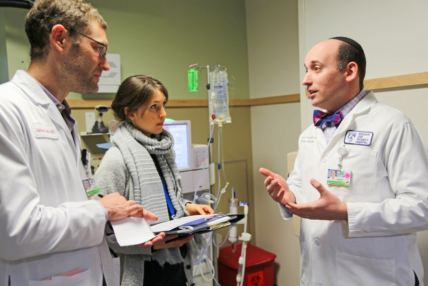 From left: Kidney Pal team members Josh Lakin and Kelsey Killeen discuss a case with nephrologist Ernest Mandel in the Dialysis Unit.