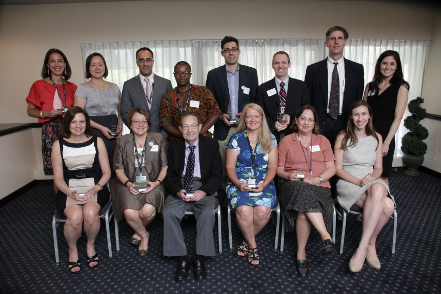 The inaugural CFDD Pillar Award recipients pose with their awards after the ceremony.