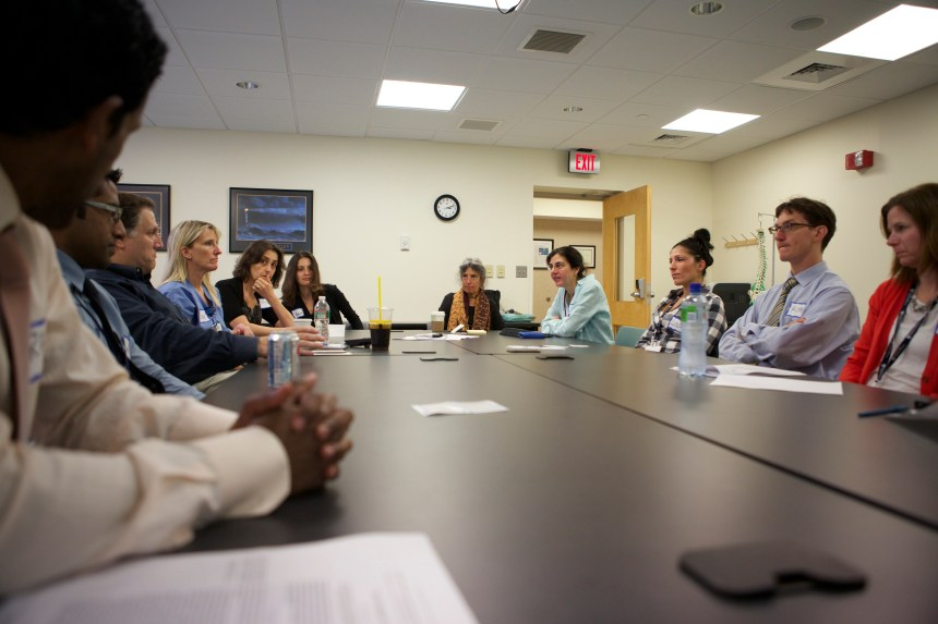 BWH physicians, nurses, nurse practitioners and physician assistants participate in Interprofessional Debriefing Course training, led by Chuck Pozner, MD, (third from left) and Dorothy Bradley, MSN, RN (not pictured).
