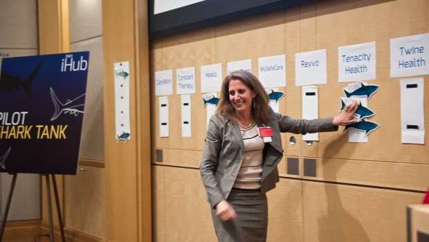 "Jessica Dudley, chief medical officer, Brigham and Women's Physician's Organization, shows her interest in partnering with Tenacity Health by placing her name—among those of other interested ""sharks"" —on the wall."