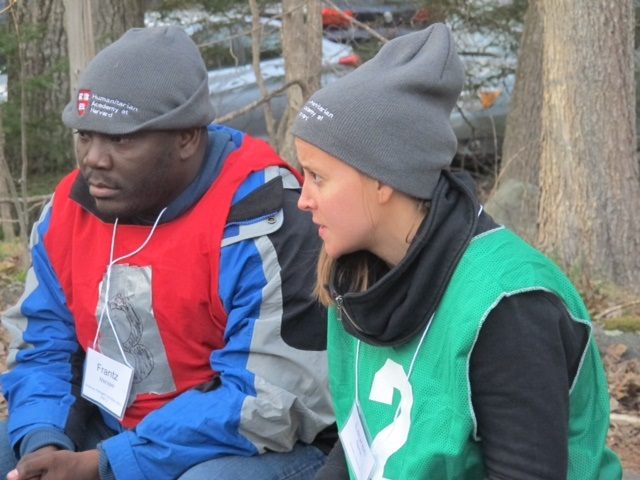 Frantz Merisier (at left) and Lauren Spink, students from this year's Humanitarian Response Intensive Course, discuss plans to help the refugee population with their teammates during the course's simulated refugee crisis. Photo courtesy of Adina Davies.