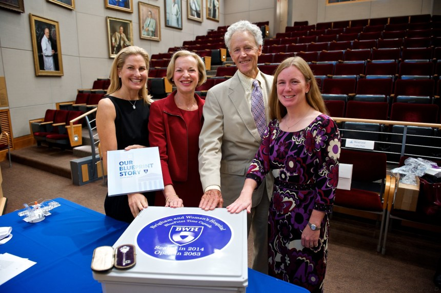 From left: Melissa Weiner Janfaza, Betsy Nabel, J. Linzee Coolidge and Brandon Earp pose with the BWH time capsule following the ceremony.