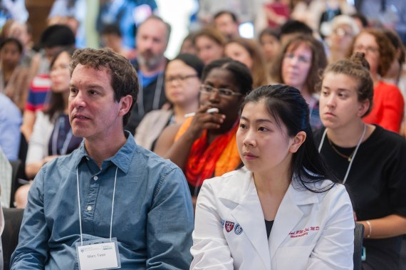 Rosalyn Lai (right) listens to guest speakers at the 2018 WBI Symposium.
