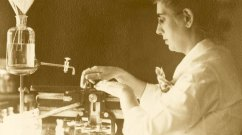 Woman in lab conducting experiment